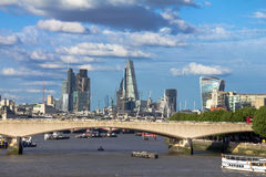 Cityscape of London in late afternoon light from Hungerford Bridge. Royalty Free Stock Photos
