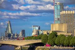 Cityscape of London in late afternoon light from Hungerford Bridge. Royalty Free Stock Images