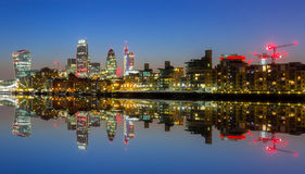 Cityscape of London at night. Cityscape of London with reflection in Thames river at night, UK Royalty Free Stock Image