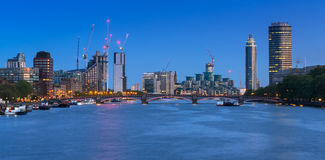 Cityscape of London with reflection in Thames river Stock Images