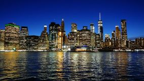 Cityscape of Lower Manhattan New York City at night stock footage