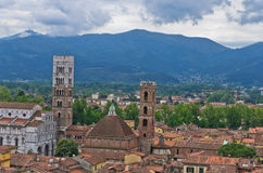Cityscape of Lucca with cathedral and surrounding mountains, Tuscany Stock Image
