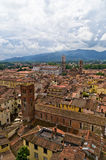 Cityscape of Lucca with cathedral and surrounding mountains, Tuscany Royalty Free Stock Photo