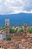 Cityscape of Lucca with cathedral and surrounding mountains, Tuscany Royalty Free Stock Photos