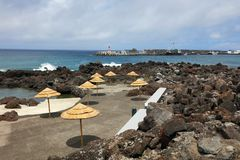 Cityscape of Madalena Resort - the beach. Madalena is a municipality along the western coast of the Pico island, encircled almost entirely by the Atlantic Ocean Royalty Free Stock Photography
