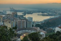 Cityscape Malaga by sunset with bulls arena stock image