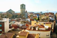 Cityscape of Malgrat de Mar, Catalonia, Spain. Aerial view of old spanish town Malgrat de Mar, roof tops, cityscape on the coast of Mediterranean sea, Costa Stock Images
