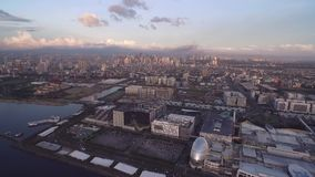 Cityscape of Manila, Philippines. Close to Bay City, Pasay with Sunset Light and business area. Close to Mall of Asia.  stock footage