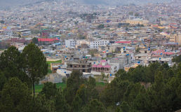 Cityscape of Mansehra Pakistan with hills and mountains. Beautiful city of mansehra with trees in forground and houses royalty free stock photo