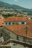 Cityscape with many rooftops and hilly landscape. Cityscape with many rooftops next to deserted pathway and hilly landscape, in a sunny day at Covilha. Known as royalty free stock images