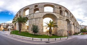 Cityscape with medieval aqueduct Kamares in the Kavala city, Macedonia. stock photography