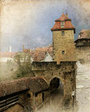 Cityscape of the medieval street with gates tower, retro toned. Rothenburg, Bavaria, Germany Stock Image