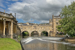 Cityscape in the medieval town Bath, Somerset, England. BATH, ENGLAND - JULY 28: Pulteney Bridge (designed by Robert Adam) over the River Avon on July 28, 2015 Stock Images