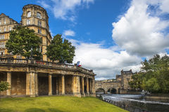 Cityscape in the medieval town Bath, Somerset, England. View of the Empire Hotel, by architect Charles Edward Davis and Pulteney Bridge over the River Avon in Stock Photos