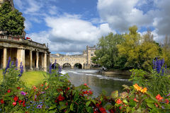 Cityscape in the medieval town Bath, Somerset, England. View of the Empire Hotel, by architect Charles Edward Davis and Pulteney Bridge over the River Avon in Stock Photo