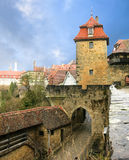 Cityscape of the medieval town gate and gates tower. Royalty Free Stock Photo