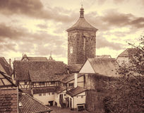 Cityscape of the medieval town with gates tower. Retro toned. Cityscape of the medieval town with gates tower. Rothenburg, Bavaria, Germany. Retro toned Royalty Free Stock Photo