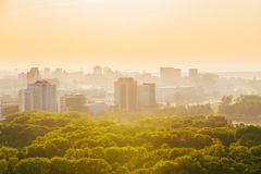 Cityscape of Minsk, Belarus. Summer season, sunset. Cityscape of Minsk, Belarus. Multi-storey buildings among the green park in summer season, sunset time Stock Photos