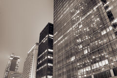 Cityscape of modern building exterior. With glass windows in night Stock Images