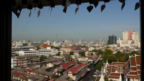 Cityscape of modern oriental town. View from the window of houses roofs on streets of majestic Bangkok from Golden Mount. Temple during sunset time. Traditional stock footage