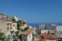 Cityscape of Monaco, view of the modern houses and bright blue sea in the background Stock Images
