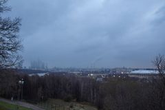 Cityscape of Moscow. Cityscape at dusk with gloomy clouds at background stock photos