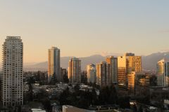 Cityscape and mountains at sunset royalty free stock image