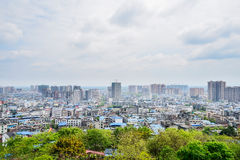 Cityscape from mountainside in cloudy spring Royalty Free Stock Photo