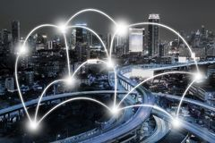 Cityscape and network connection concept in the city at night. B royalty free stock photo