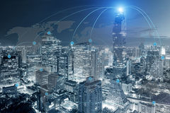 Cityscape and network connection with world map Stock Photos