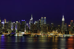 New York Manhattan at Night. Cityscape of New York Midtown Manhattan at Night from JFK Boulevard East in New Jersey. New York is the most populous city in the Royalty Free Stock Photography