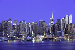 New York Manhattan at Night. Cityscape of New York Midtown Manhattan at Night from JFK Boulevard East in New Jersey. New York is the most populous city in the Stock Photos