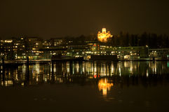 Cityscape at Night. A nightly cityscape reflecting from the water in the harbor of Lappeenranta Royalty Free Stock Image
