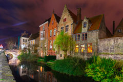 Cityscape with the night canal in Bruges. Scenic cityscape with the picturesque night medieval canal in Bruges, Belgium Stock Photos