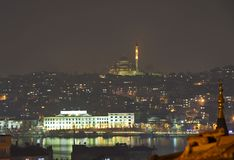 Cityscape at night with a large mosque Stock Photography