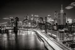 Cityscape at night of Lower Manhattan Financial District with illuminated skyscrapers. New York City Black & White. Elevated view of Lower Manhattan skyscrapers Royalty Free Stock Photos