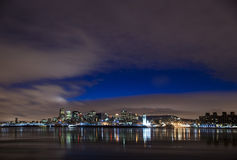 Cityscape night scene Montreal Canada river Royalty Free Stock Image