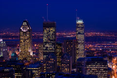 Cityscape night scene Montreal skyscraper. Cityscape dusk twilight scene of downtown city Montreal view from Mont Royal skyscraper and other buildings with Stock Photography