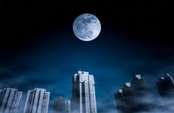 Cityscape at night time with fogy and darkness blue sky super moon full of many stars. The moon taken with my camera royalty free stock photo