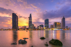 Cityscape ( night view ) of Saigon river at downtown ( center ) of ho chi minh city, Vietnam in sunrise or sunset Royalty Free Stock Photography