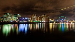 Cityscape at Nighttime Reflecting on Body of Water Royalty Free Stock Photos