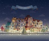 Cityscape och snöfall för julnatt Arkivfoto