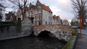 Cityscape with old bridge and typical Flemish houses. Bruges stock video