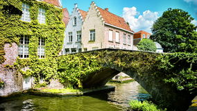 Cityscape with old bridge and typical Flemish houses. Bruges, Belgium. stock footage