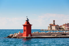 Cityscape of the old city Piran with medieval and new lighthouses Royalty Free Stock Photo