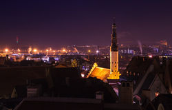 Cityscape of old Tallinn at night, Holy Spirit Church Royalty Free Stock Images