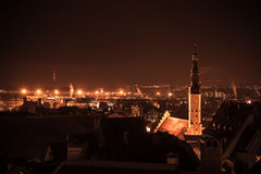 Cityscape of old Tallinn at night, Holy Spirit Church Royalty Free Stock Image