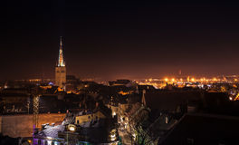 Cityscape of old Tallinn at night, St Olaf Church spire Stock Photo