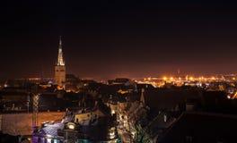 Cityscape of old Tallinn at night, St Olaf Church spire Stock Photo