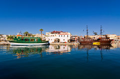 Cityscape of the old venetian harbor at morning, city of Rethymno, Crete. Greece Royalty Free Stock Photo